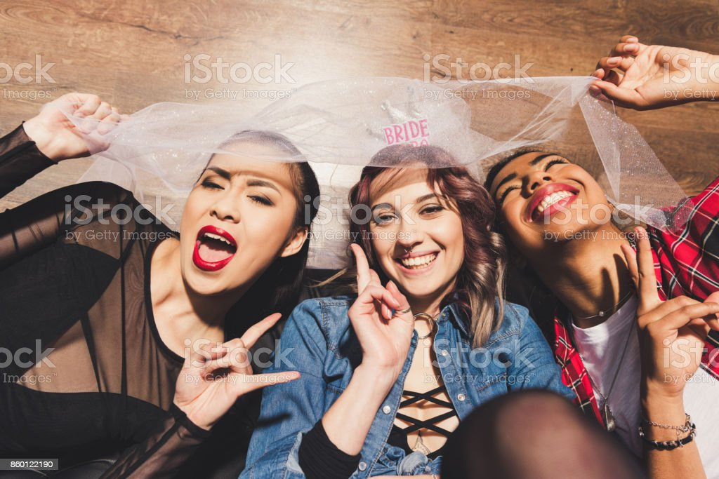 fiance and multicultural friends stock photo