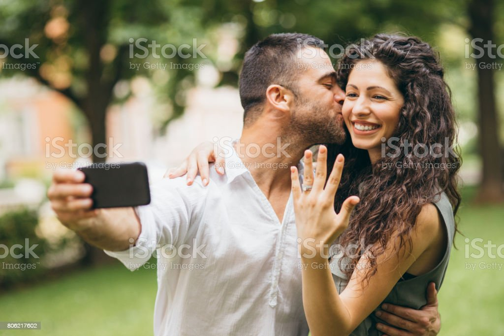 Fiances taking a selfie stock photo