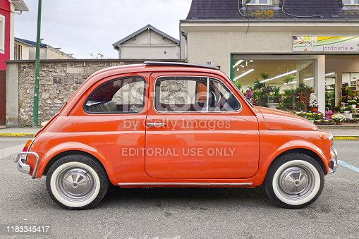 Lamorlaye, France - October 24 2019: The Fiat 500 (Italian: Cinquecento) is a rear-engined, four-seat, small city car that was manufactured and marketed by Fiat Automobiles from 1957 to 1975 over a single generation in two-door saloon and two-door station wagon bodystyles.