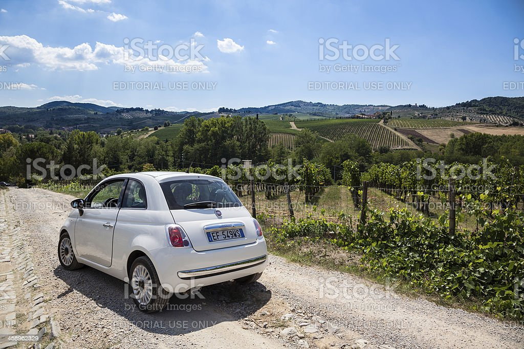 Fiat 500 inside a Vineyard in Chianti area Italy stock photo