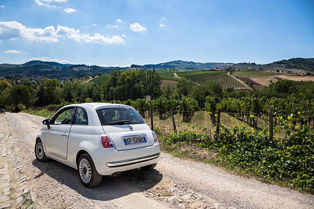 Fiat 500 inside a Vineyard in Chianti area Italy stock photo
