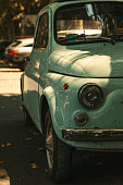 Fiat 500 vintage car on the street in Rome\n\n+++ Note for inspector: the fiat 500 is a car from 1957 +++