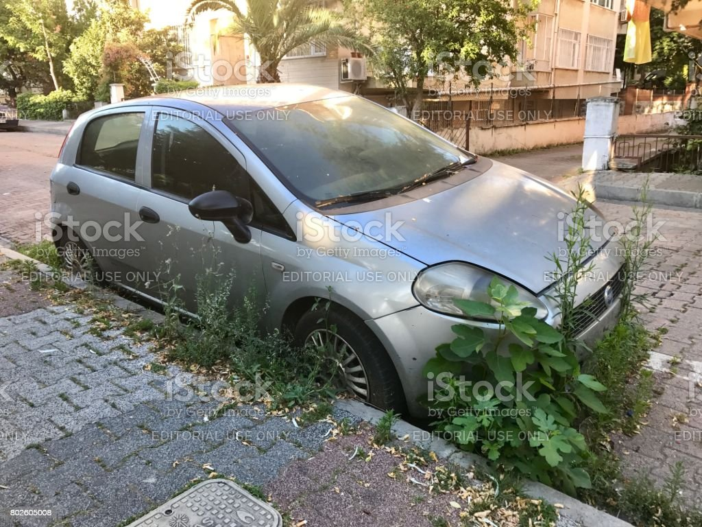 Fiat punto abandoned in the street stock photo