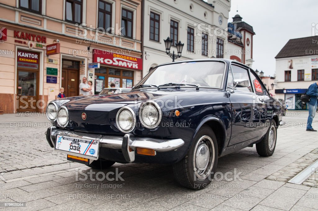 Fiat sport 850, retro design car. Exhibition of vintage cars. Rally of old vintage vehicles. Collectors unique cars. Dark blue with round lights. – zdjęcie