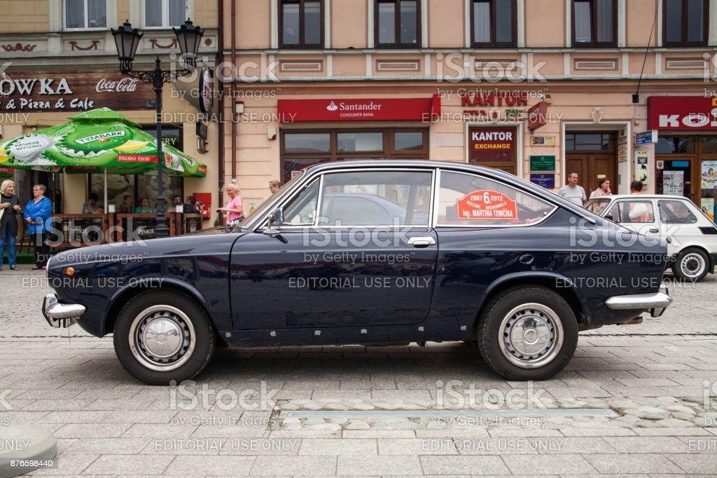 Fiat sport 850, side view, retro design car. Exhibition of vintage...