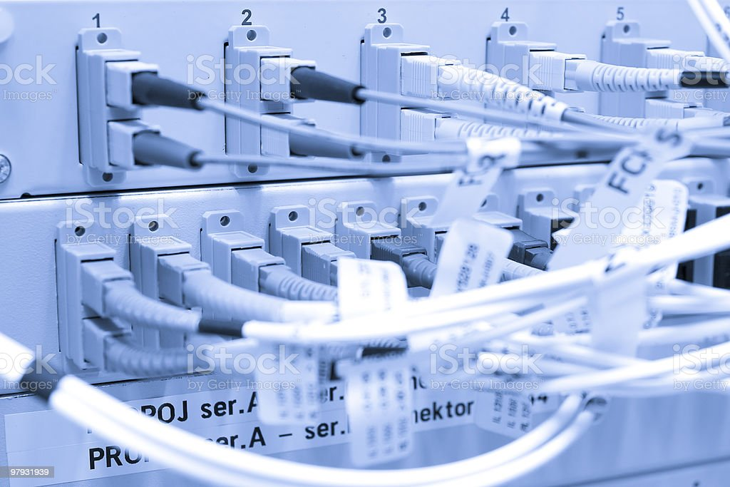 Fiber cables connected to servers royalty-free stock photo