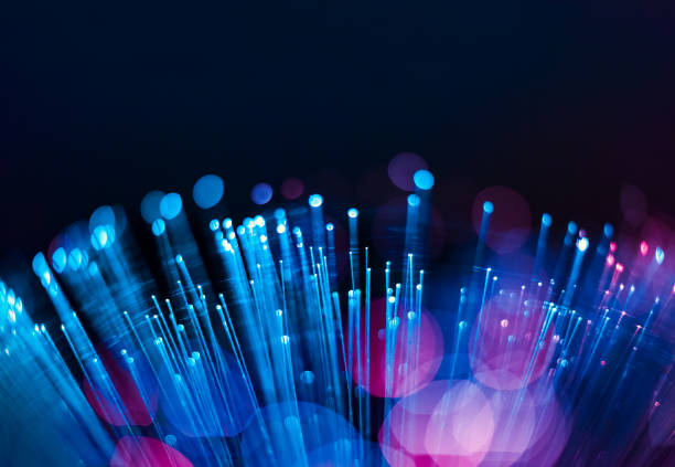 Fiber Optic Background Fiber optics close-up, focal point on distant fibres optical instrument stock pictures, royalty-free photos & images