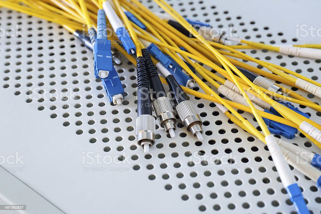 fiber optic cables in data center stock photo