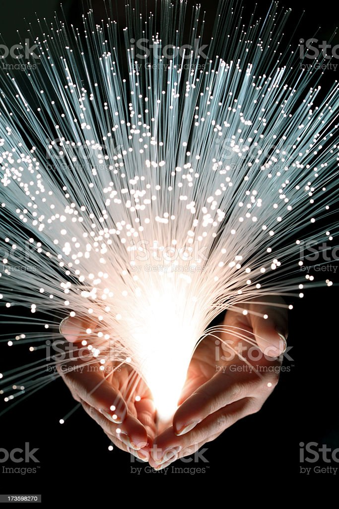 Fiber optic in the hand royalty-free stock photo