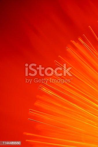 istock Fiber optics abstract background (red) 1144485550