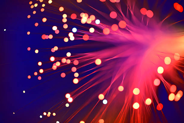 fiber optics abstract background (blue-purple) - soft focus stock photos and pictures