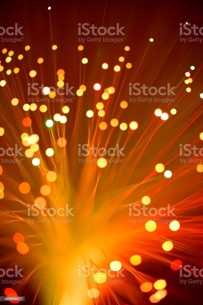 Fiber optics abstract background (orange - red) stock photo