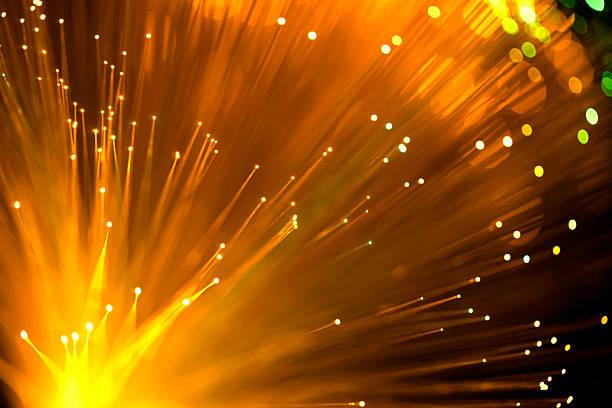 Fiber optics abstract background (orange) stock photo
