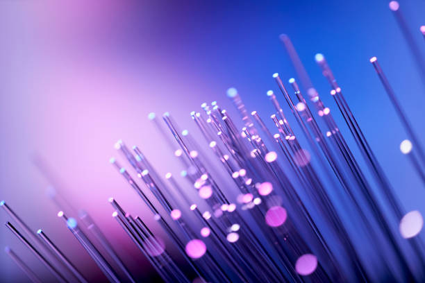 Fiber optics abstract background - Purple Blue Data Internet Technology Cable stock photo