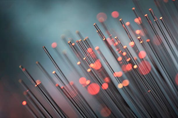 Fiber optics abstract background - Red Data Internet Technology Cable stock photo