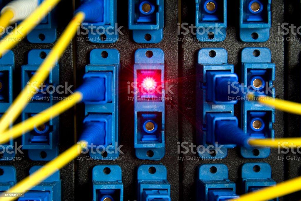 fiber optics switch panel with red laser beam royalty-free stock photo