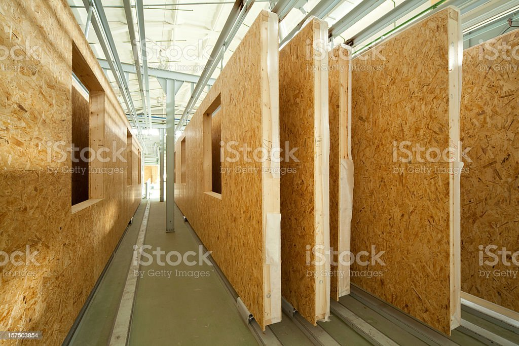 Fiberboard walls lined up in a factory lumber yard stock photo