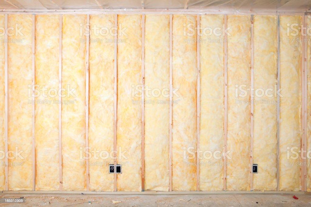 Fiberglass Batt Insulation between House Wall Studs stock photo