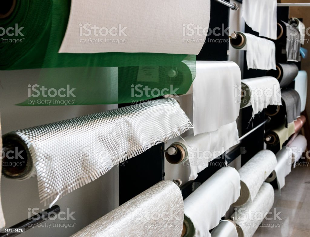 Fiberglass composite fabrics hanging on a wall dispenser stock photo