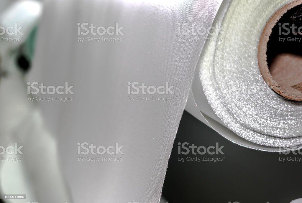 Fiberglass fabric composite roll material stock photo