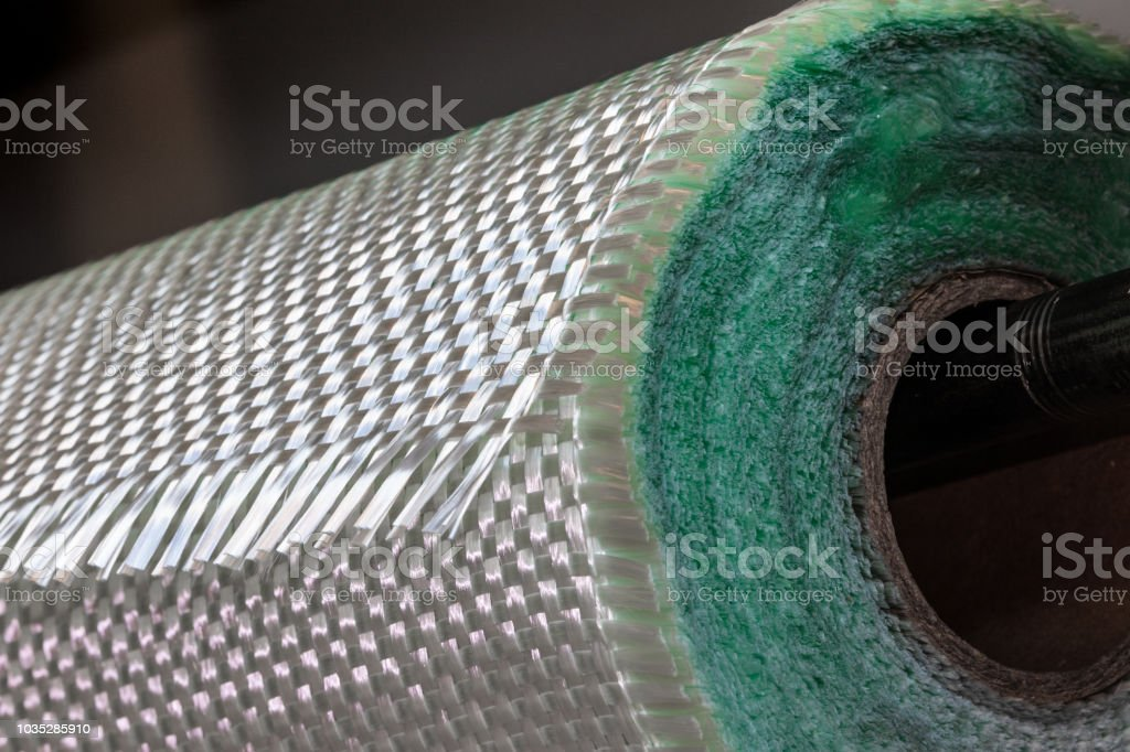 Fiberglass fabric composite roll material stock photo