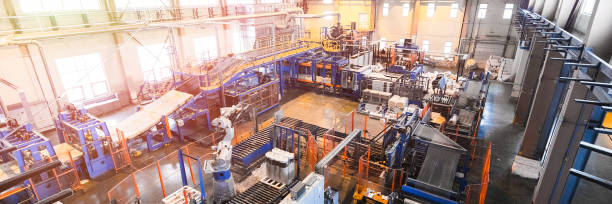 Fiberglass production industry equipment at manufacture background stock photo