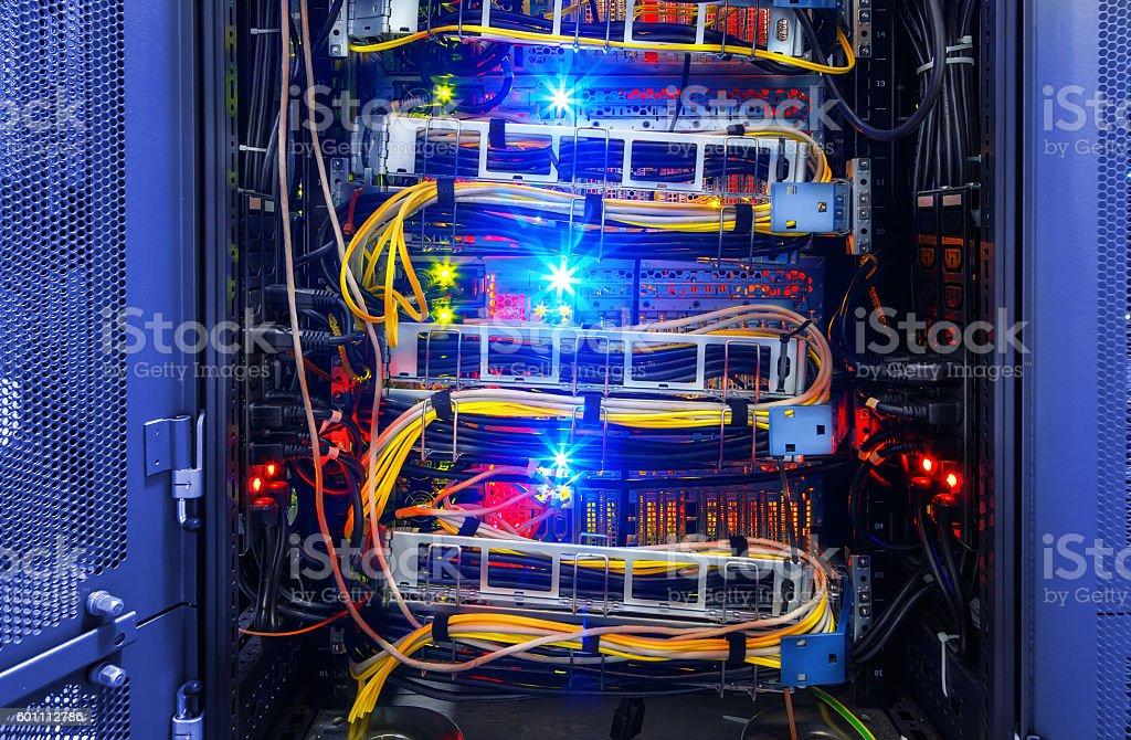 Fiber-optic equipment in modern data center stock photo