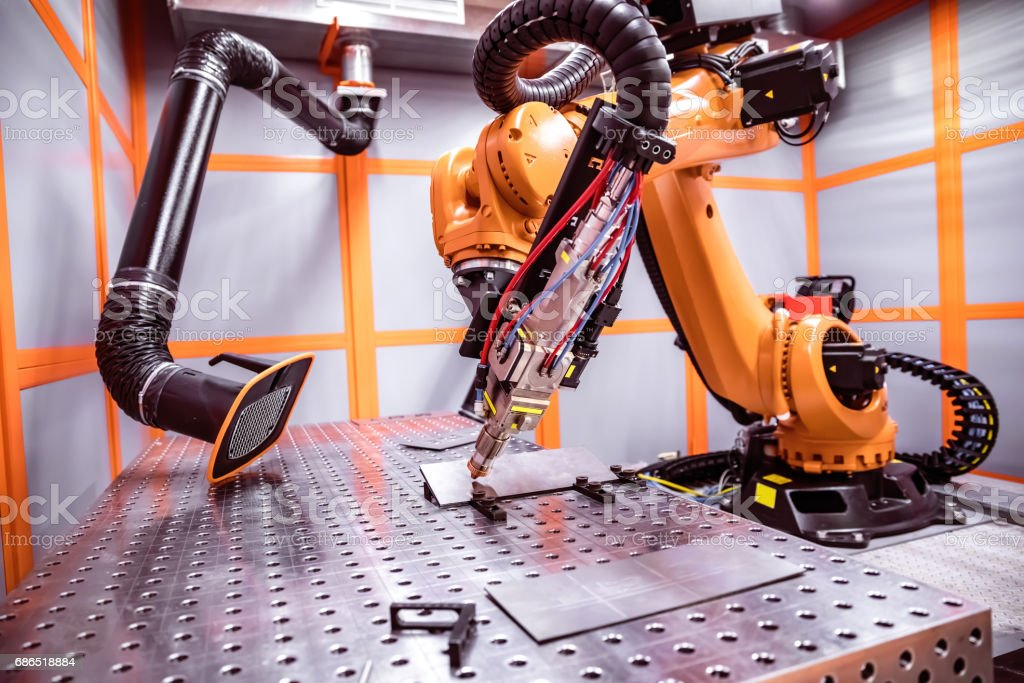 Fibre laser robotic remote cutting system foto stock royalty-free