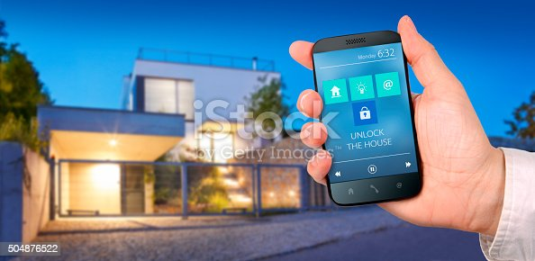 istock Fictive mobile app controlling the modern house 504876522