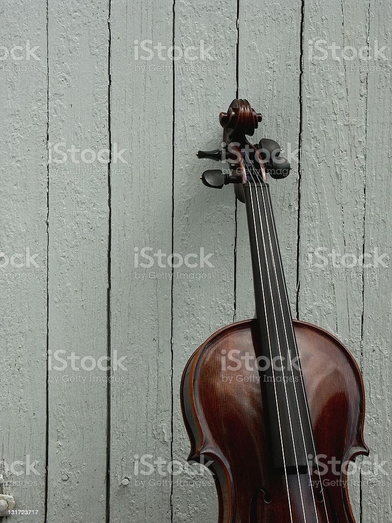 Fiddle with board background royalty-free stock photo