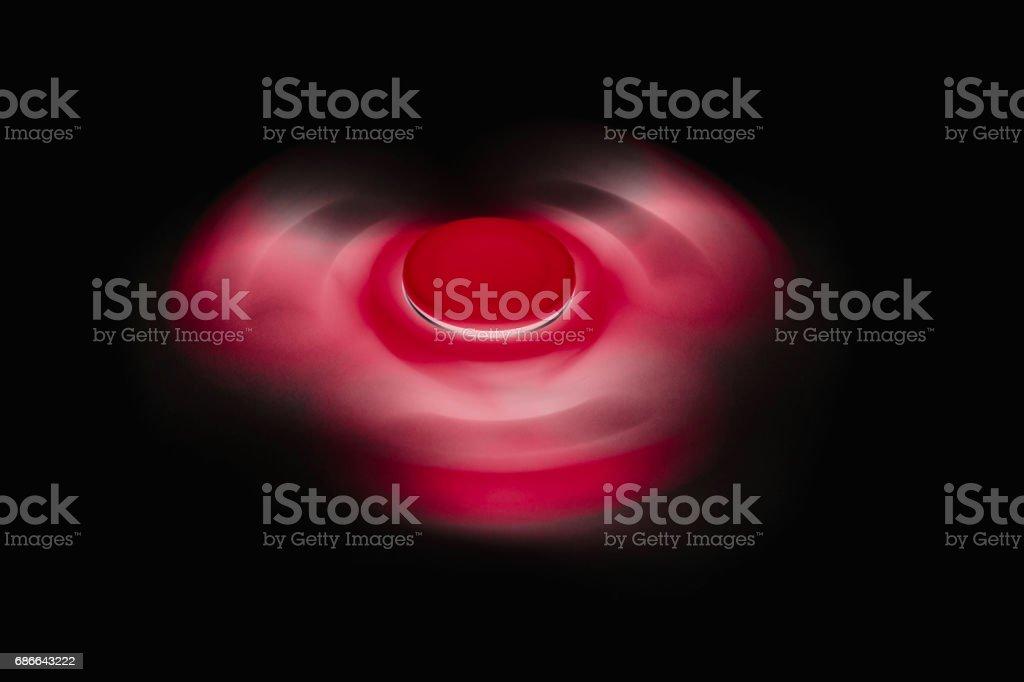 Fidget Spinner in black isolated background Стоковые фото Стоковая фотография