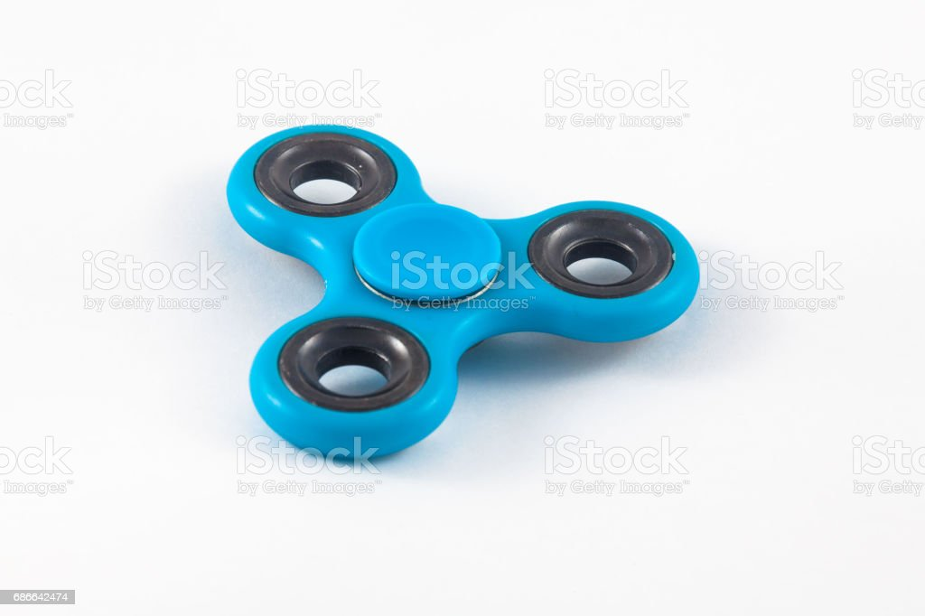 Fidget Spinner in white isolated background royalty-free stock photo