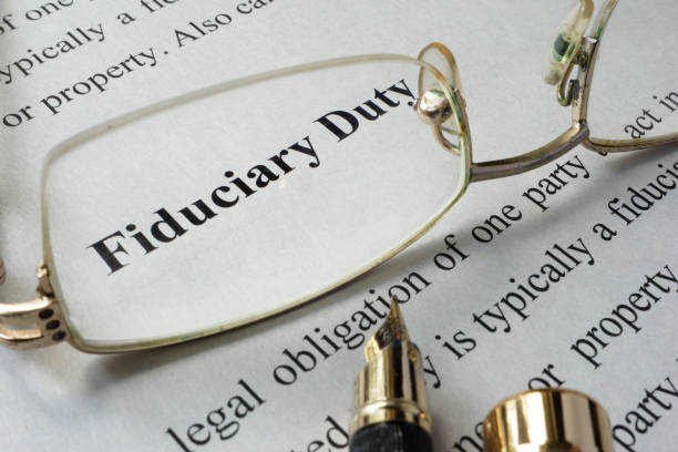 Fiduciary duty concept written on a paper. stock photo