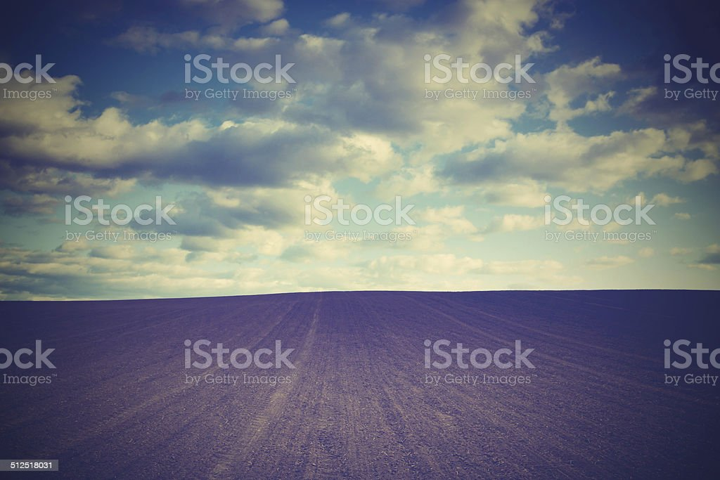 field and clouds stock photo