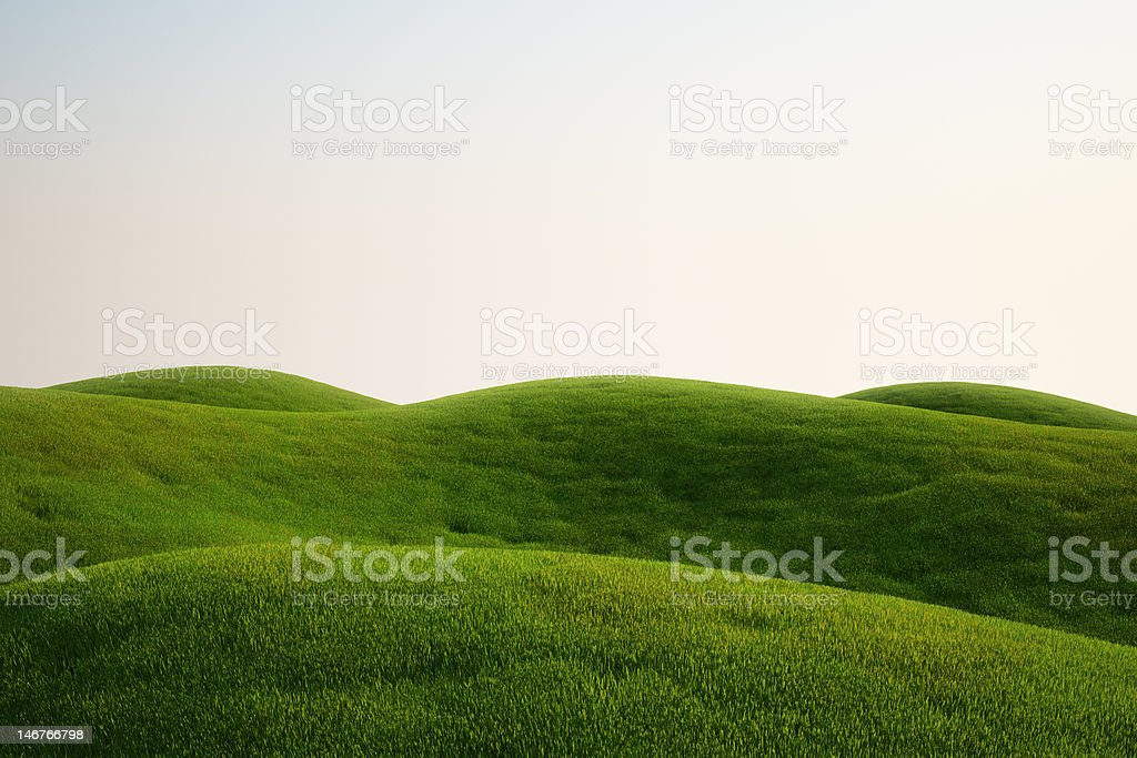 A field full of green grass and hills stock photo