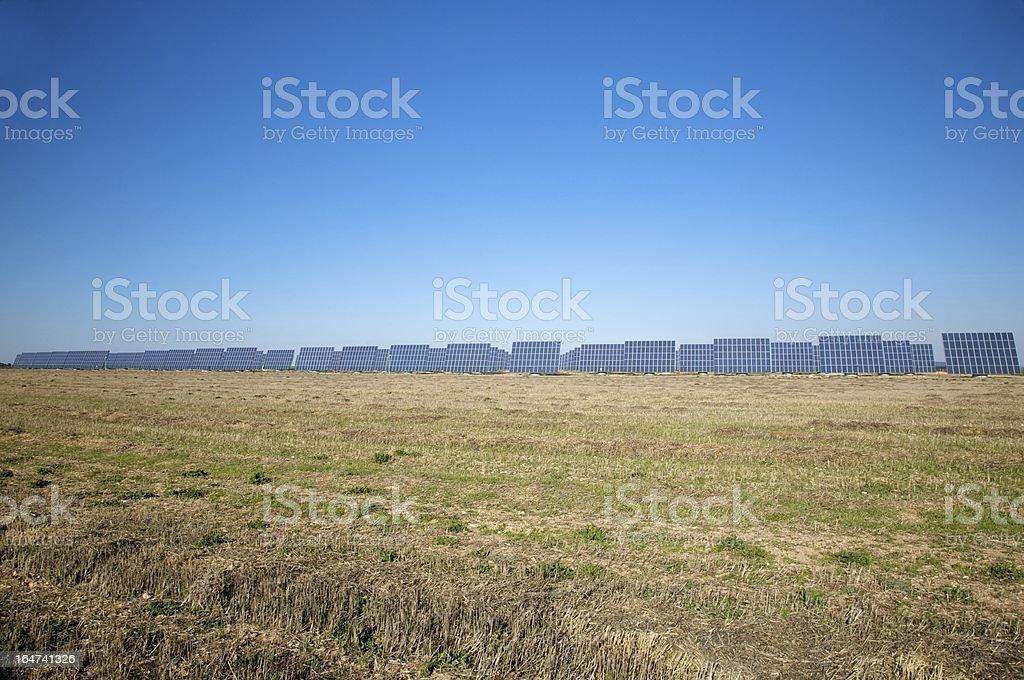 field full of solar panels royalty-free stock photo