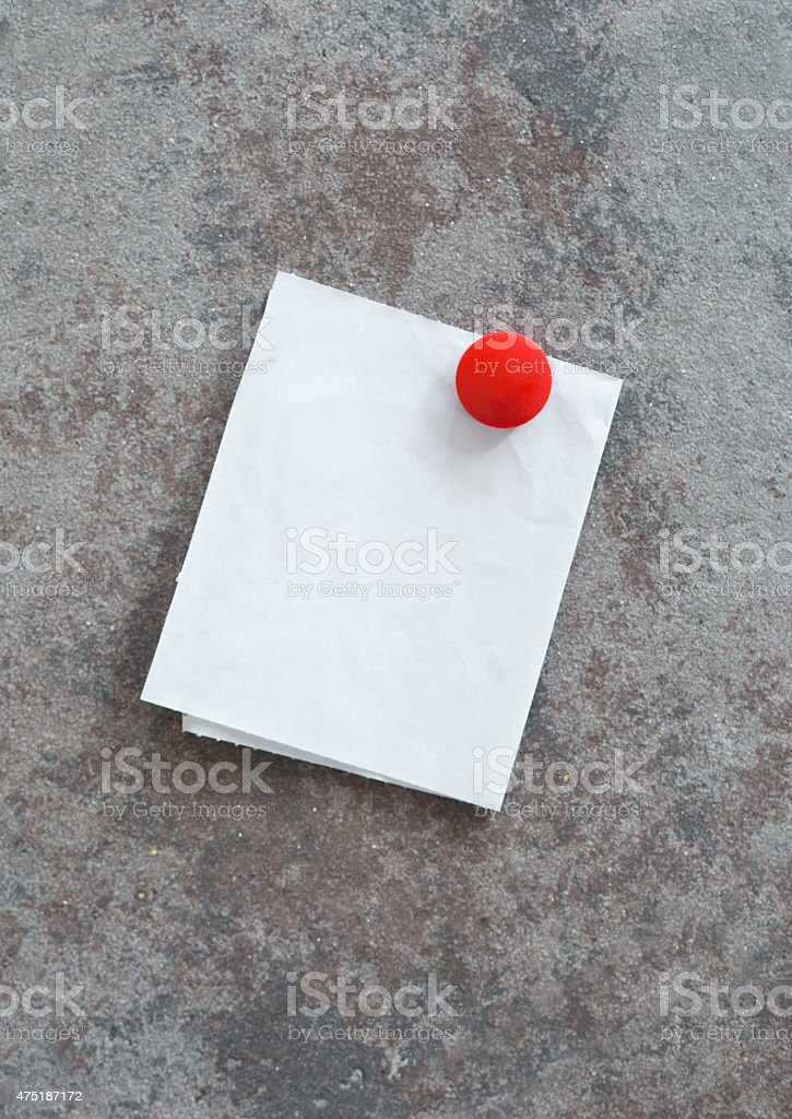 Field Note with Red Round Button stock photo