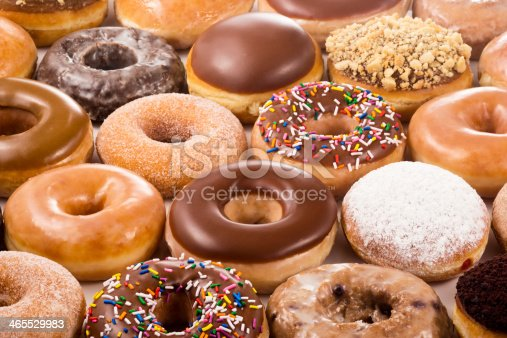 A field of donuts in many different flavors.