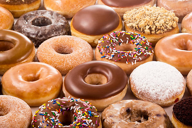 Field of Different Types of Donuts stock photo