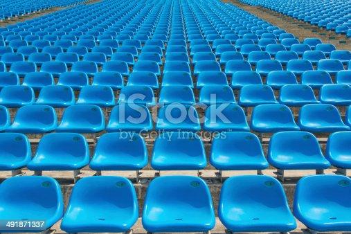 171581046istockphoto Field of empty blue plastic stadium seats. 491871337