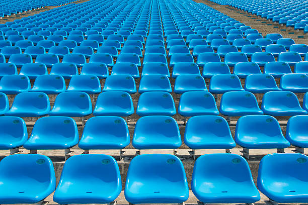 Field of empty blue plastic stadium seats. stock photo