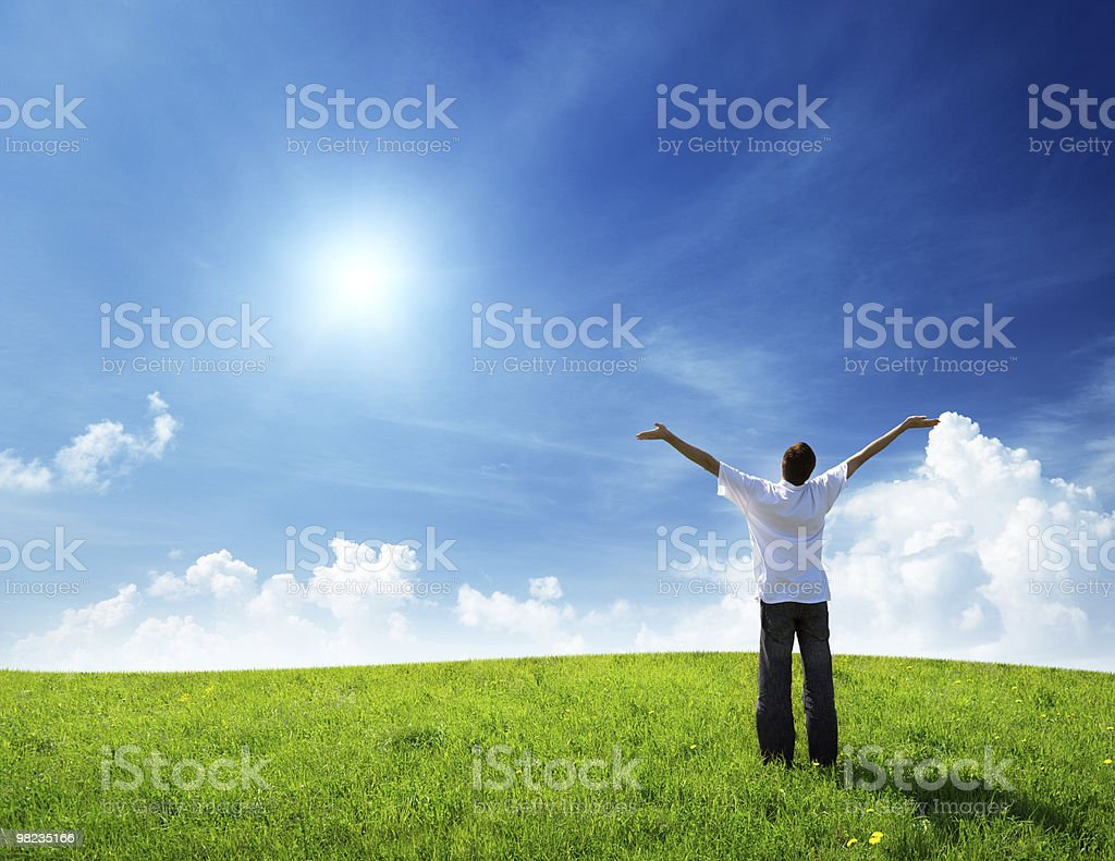 field of grass and happy young man royalty-free stock photo