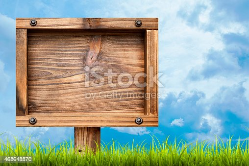 istock Field of green grass and sky with  signboard 468648870