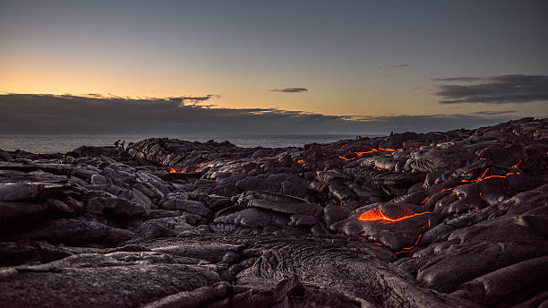 Field of lava on the Pacific coast at dawn Walking on a field of lava on the Pacific coast near Kalapana on the Big Island of Hawaii at dawn. volcanic landscape stock pictures, royalty-free photos & images