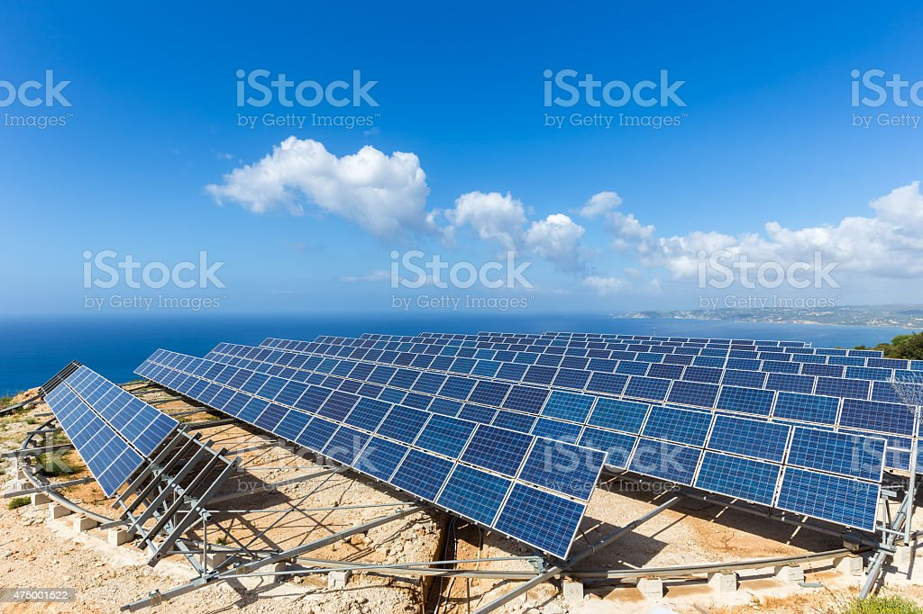 Field of solar collectors near sea stock photo