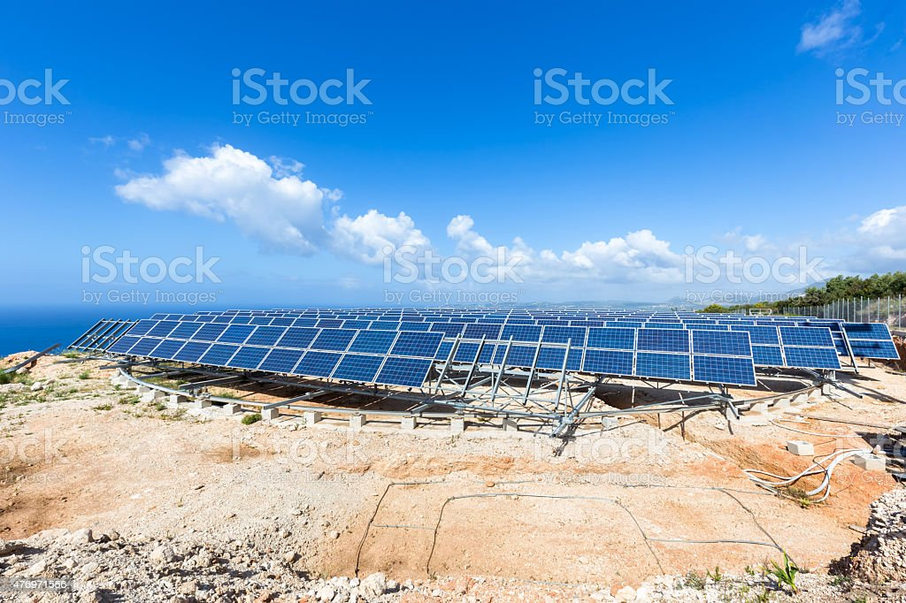 Field of solar collectors on rotatable construction stock photo