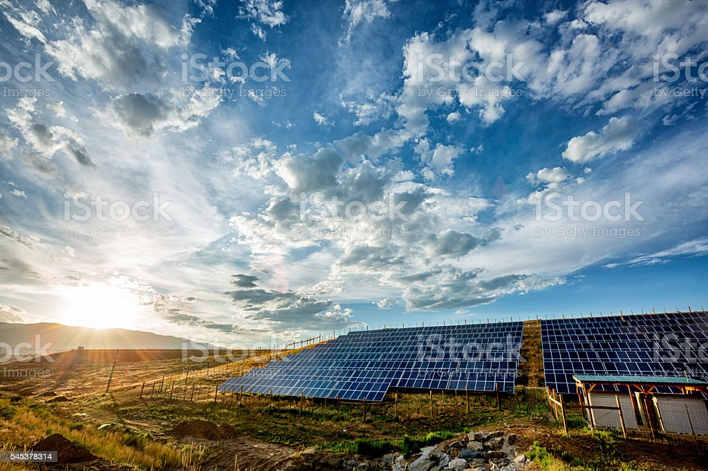 Field Of Solar Panels In A Rural Setting stock photo