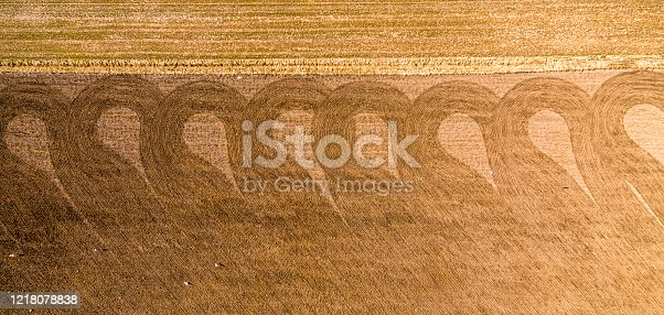 pattern on a harvest field from a tractor harvesting