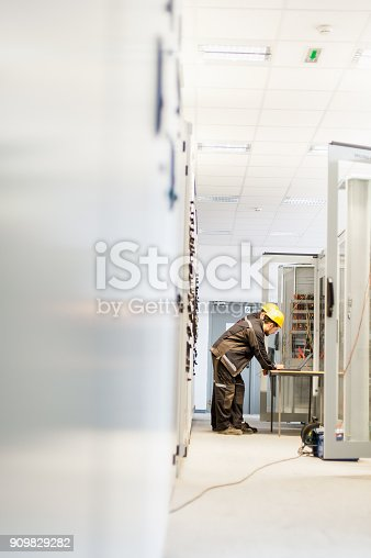 istock Field service crew testing electronics or inspecting electrical installation system 909829282