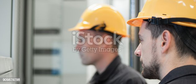 istock Field service crew testing electronics or inspecting electrical installation system 909829298
